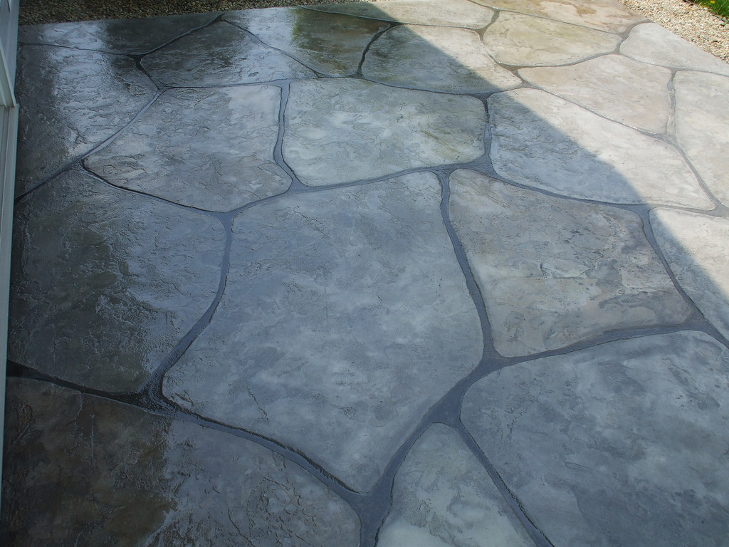 Picture of stamped concrete patio is concrete sealer to give a wet look.