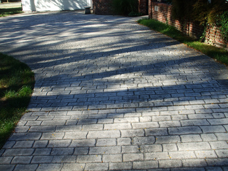 Residential stamped concrete driveway in Jackson, Michigan.