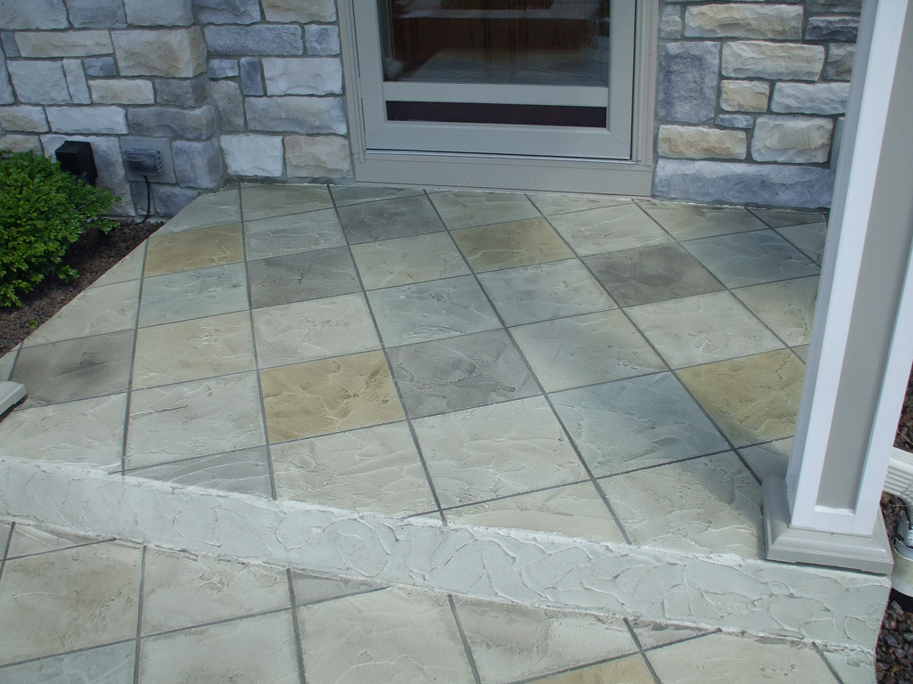 Front porch entry way with a stamped concrete finish.